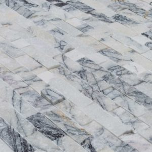 20012459-split-face-lilac-marble-stacked-stone-ledger-panel-6x24-close-angle-view-model-a-www.thulahome.com